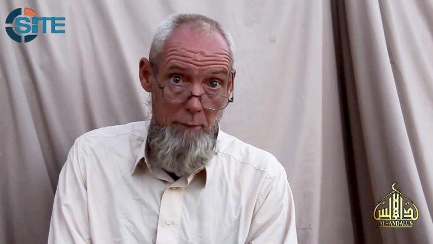 Capture d'écran d'une vidéo publiée par le SITE Intelligence Group le 17 novembre 2014 et montrant l'otage néerlandais Sjaak Rijke, retenu par Aqmi