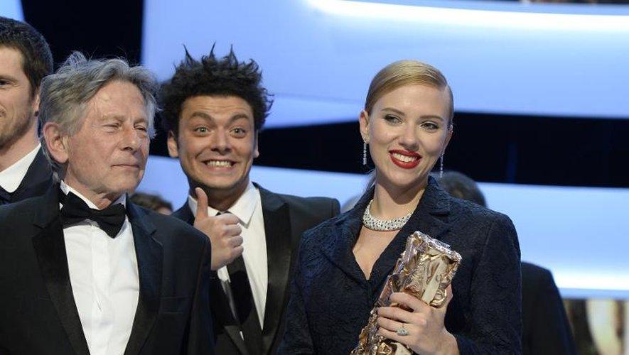 Roman Polanski, Kev Adams et Scarlett Johansson lors de la 39e cérémonie des Césars le 28 février 2014 au Châtelet à Paris