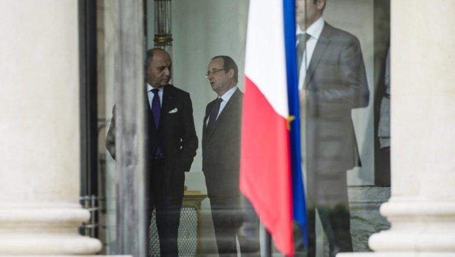 Laurent Fabius et François Hollande le 21 juin 2013 au palais de l'Elysée à Paris
