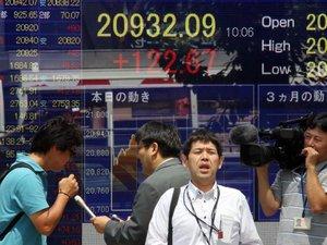 Grèce: les marchés asiatiques inquiets battent en retraite