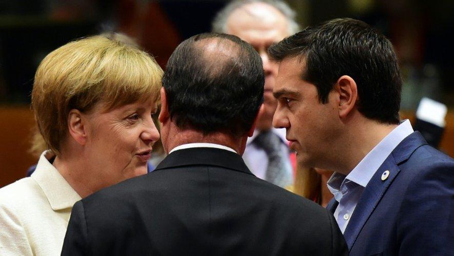 La chancelière allemande Angela Merkel, le président français François Hollande, et le Premier ministre grec Alexis Tsipras le 12 juillet 2015 à Bruxelles