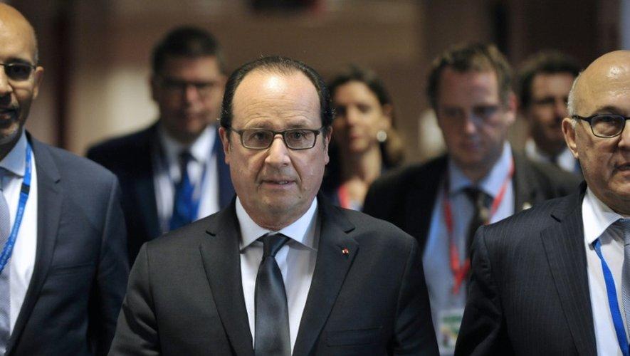 Le président François Hollande à son arrivée pour uen conférence de presse sur la Grèce le 13 juillet 2015 à Bruxelles