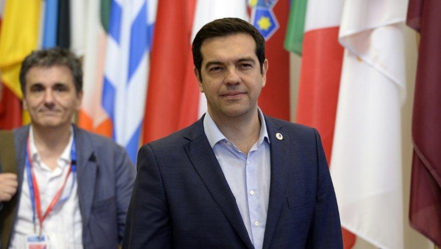 Le Premier ministre grec Alexis Tsipras et son ministre des Finances Euclide Tsakalotos à l'issue du sommet de l'Eurogroupe le 13 juillet 2015 à Bruxelles