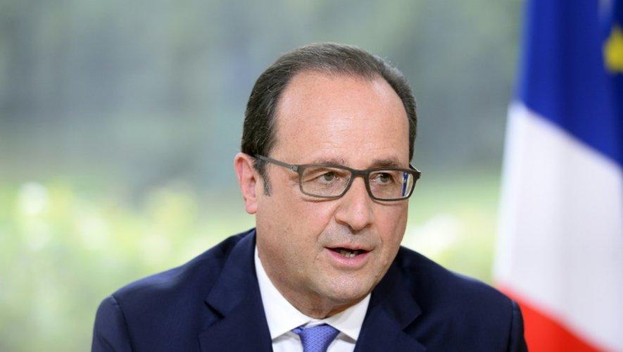 Le président français François Hollande au palais de l'Elysée à Paris le 14 juillet 2015