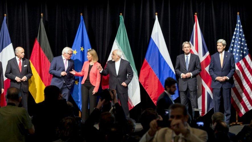 Les principaux diplomates qui ont oeuvré à la conclusion d'un accord sur le nucléaire iranien posent le 14 juillet 2015 à Vienne