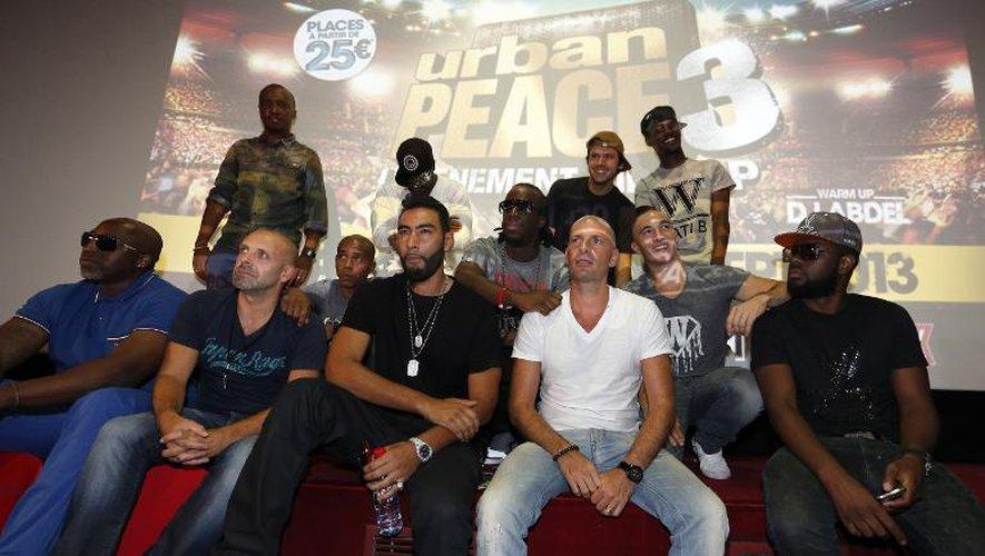 Les rappeurs français des groupes IAM, Sexion d'Assaut et La Fouine posent le 5 septembre 2013 à Paris