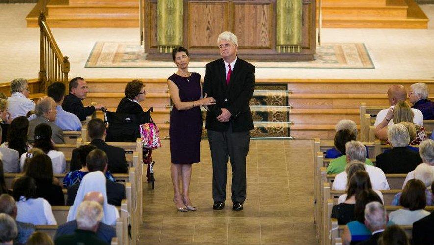 Diane et John Foley, les parents du journaliste américain sauvagement executé, à l'église Our Lady of the Rosary, à Rochester, le 24 août 2014