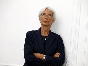 """Arbitrage Tapie :  mise en examen pour """"négligence"""", Lagarde exclut de quitter le FMI"""