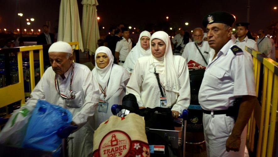 Des pélerins égyptiens à l'aéroport du Caire, le 25 août 2016