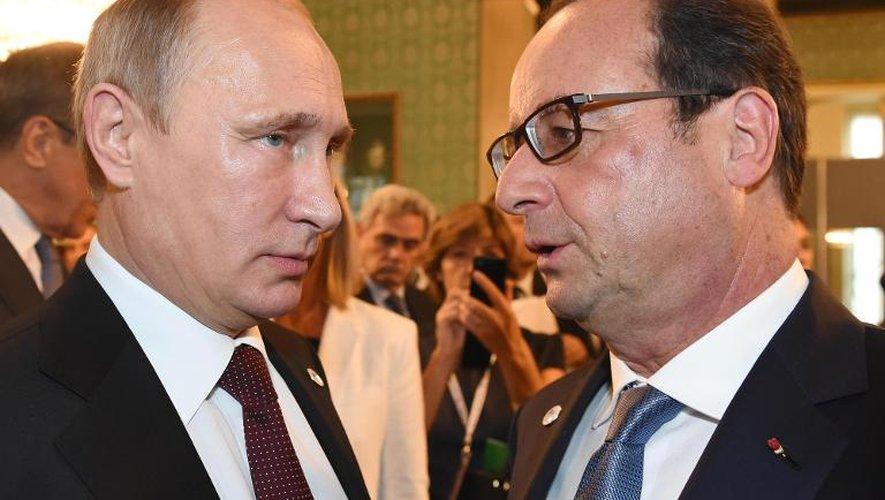 François Hollande et le président de la Russie, Vladimir Poutine, le 17 octobre 2014 à Milan