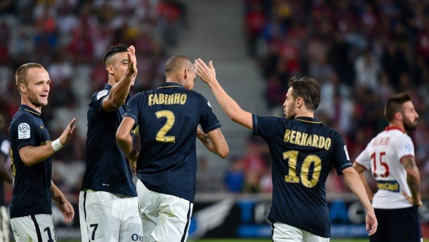 Les Monégasques autour de Fabinho, auteur du 3e but de son équipe à Lille, le 10 septembre 2016
