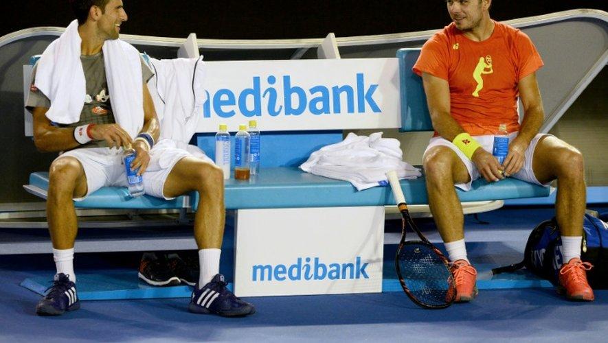 Novak Djokovic et Stan Wawrinka, le 14 janvier 2016 à Melbourne lors d'un entraînement pendant l'Open d'Australie