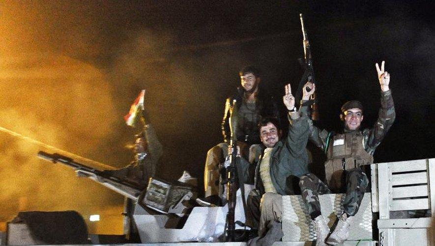 Des peshmergas kurdes en route pour la ville syrienne de Kobané, le 31 octobre 2014