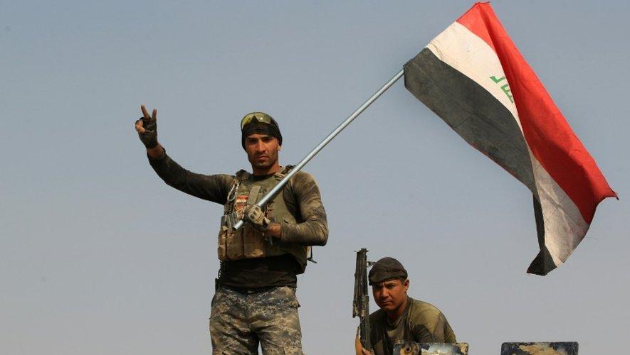 Les forces gouvernementales irakiennes dans la localité d'al-Khuwayn (sud de Mossoul) reprise aux combattants du groupe Etat islamique, le 23 octobre 2016