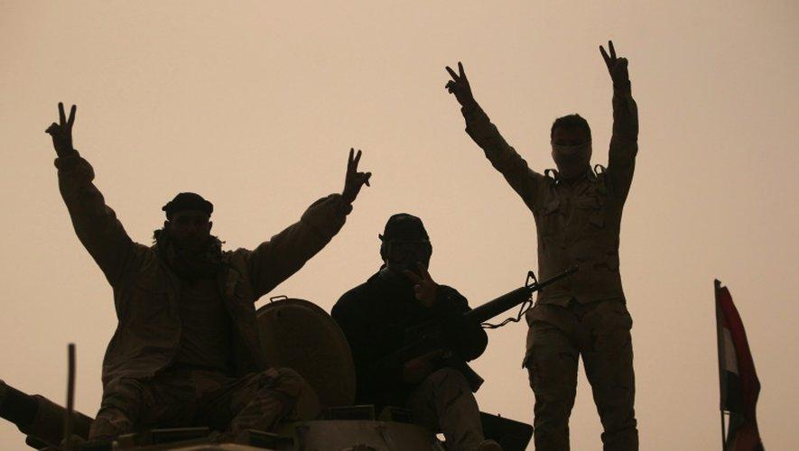Des membres des forces irakiennes à AL-Shurah, au sud de Mossoul, le 24 octobre 2016