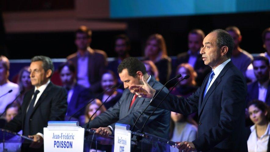 (De d. à g.) Jean-François Copé, Jean-Frédéric Poisson   Nicolas Sarkozy lors du second débat télévisé de la primaire de la droite et du centre