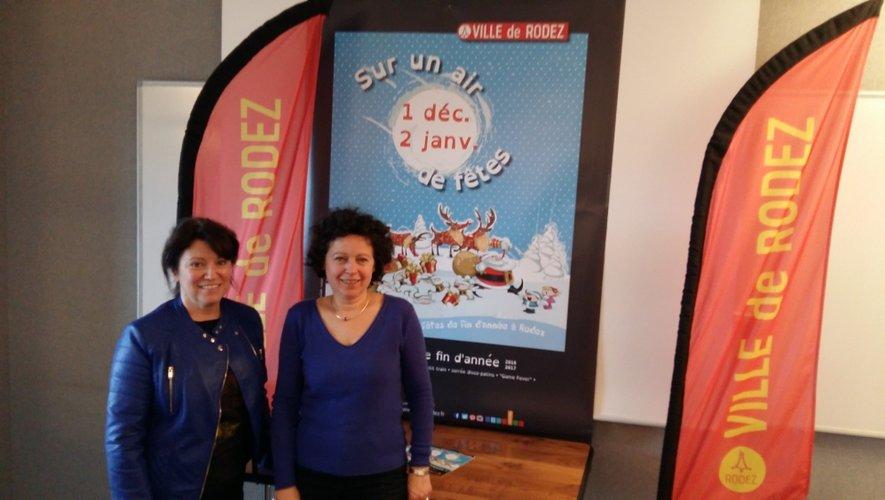 Monique Herment-Bultel et Martine Bezombes devant la nouvelle affiche des fêtes de fin d'année.