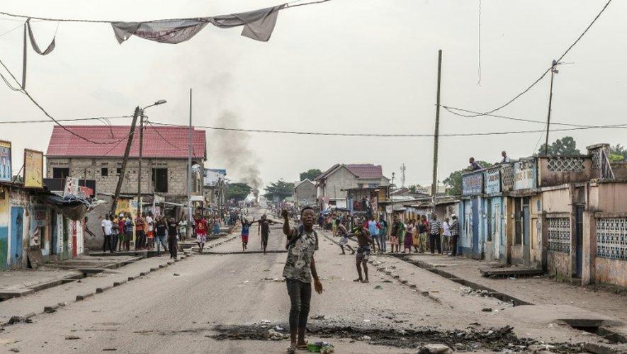 Un homme crie lors d'un rassemblement dans le quartier de Yolo à Kinshasa, le 20 décembre 2016