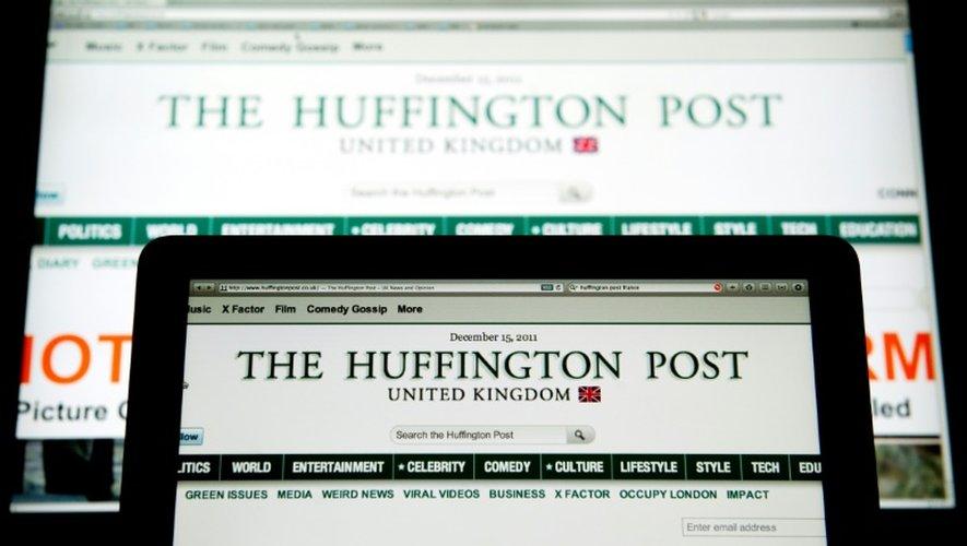 Photo d'archives datant du 15 décembre 2011 d'écrans présentant le portail d'information The Huffington Post à Paris