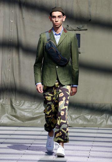 Le style militaire est à l'honneur chez Junya Watanabe Man avec du kaki et des imprimés camo à foison. Paris, le 22 juin 2018.