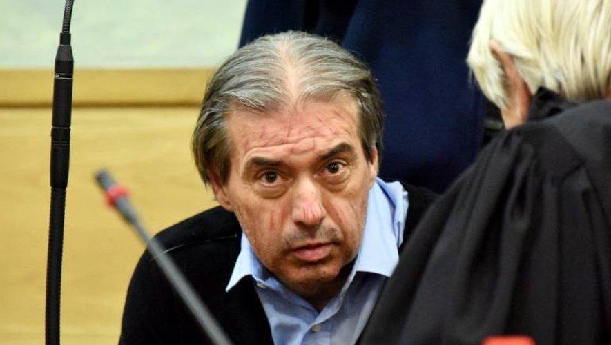 Jean-Louis Cayrou, le visage scarifié, lors de son jugement aux assises de l'Aveyron en 2016.