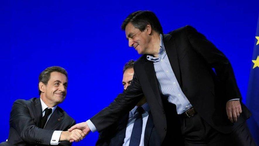 Nicolas Sarkozy et François Fillon lors du conseil national des Républicains le 13 février 2016 à Paris