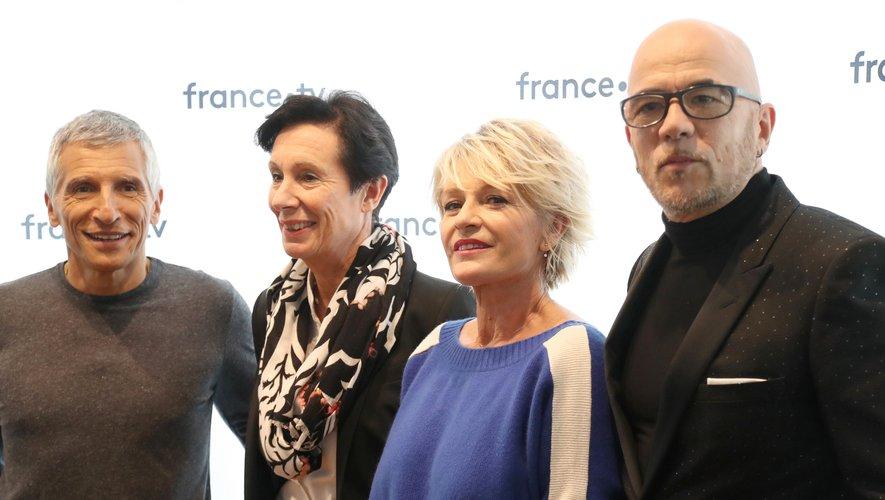 De gauche à droite, Nagui, Laurence Tiennot-Herment, présidente de l'Association française contre les myopathies, Sophie Davant et Pascal Obispo, parrain du Téléthon 2018