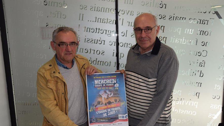 Les organisateurs Roland Girbal et Daniel Marti présentent l'affiche de la manifestation.
