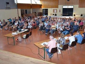 Une assemblée générale suivie par un nombreux public.