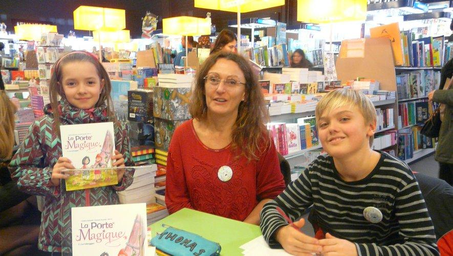 Thomas et Valérie avec une de leurs lectrices.