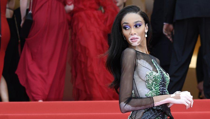 La top Winnie Harlow a monté les marches du Palais des festivals à Cannes dans une robe audacieuse tout en transparence signée Ralph & Russo. Cannes, le 22 mai 2019.