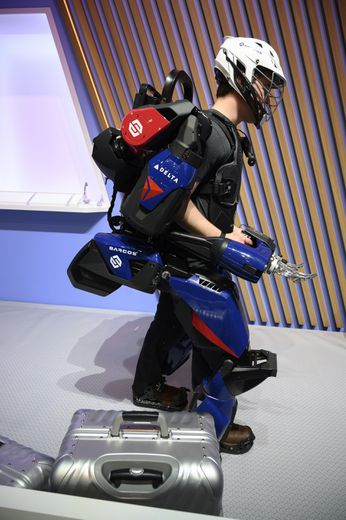 A man demonstrates the capabilities of the Sarcos Guardian XO exoskeleton at the 2020 Consumer Electronics Show (CES) in Las Vegas