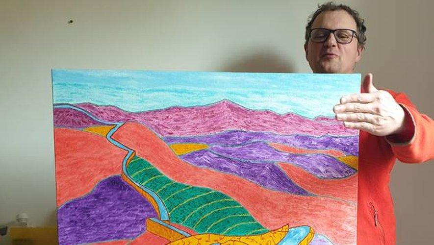 Jean-Baptiste Nortier avec le tableau qu'il utilise