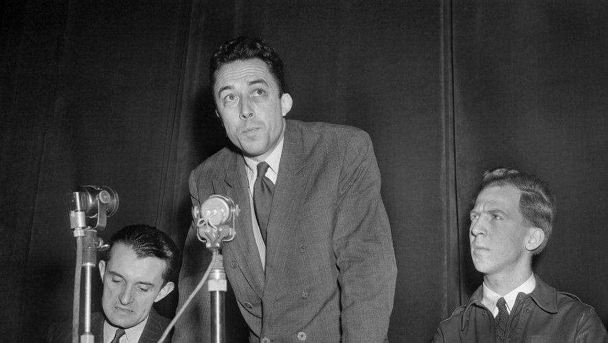 French writer Albert Camus (C) speaks at a meeting in the Salle Pleyel in Paris